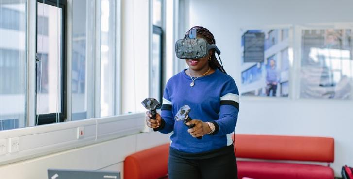 Young woman holding virtual reality headset
